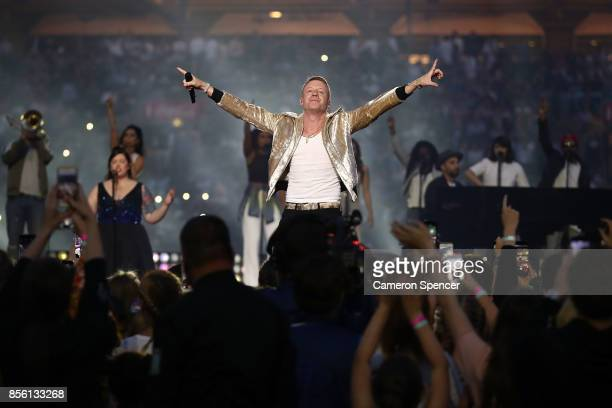 Macklemore performs before the 2017 NRL Grand Final match between the Melbourne Storm and the North Queensland Cowboys at ANZ Stadium on October 1...