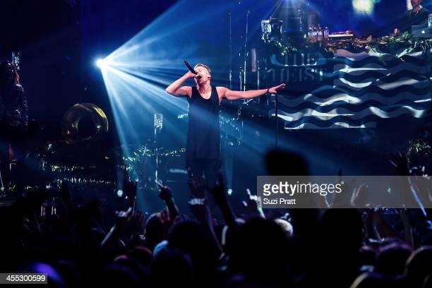 Macklemore performs live at Key Arena on December 11 2013 in Seattle Washington