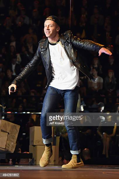Macklemore performs on stage during the MTV EMA's 2015 at the Mediolanum Forum on October 25 2015 in Milan Italy
