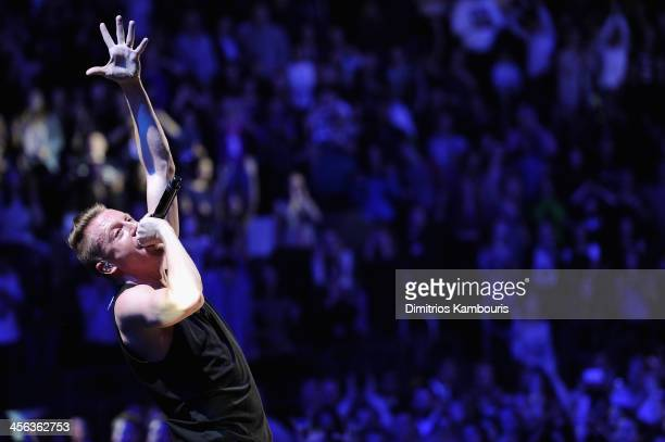 Macklemore performs onstage during Z100's Jingle Ball 2013 presented by Aeropostale at Madison Square Garden on December 13 2013 in New York City