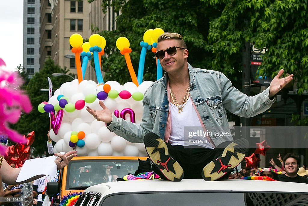 Macklemore rides on the roof of his Cadillac during the 40th annual Seattle Pride Parade on June 29, 2014 in Seattle, Washington.