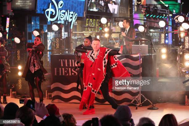 Macklemore & Ryan Lewis perform on stage ahead of midnight at The New Year's Eve 2014 Celebration in Times Square on December 31, 2013 in New York...