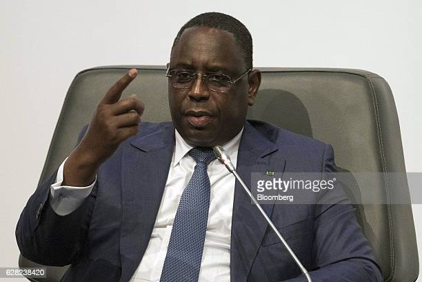 Macky Sall Senegal's president gestures as he speaks during the International Forum on Peace and Security In Africa in Dakar Senegal on Tuesday Dec 6...