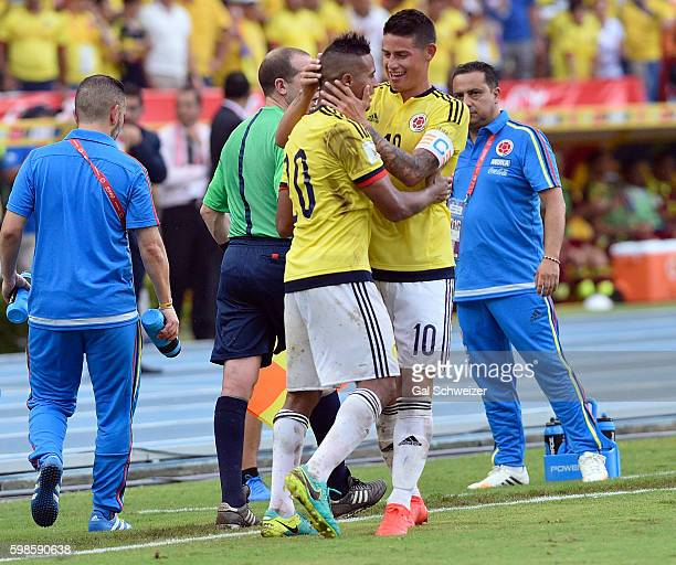 Macnelly Torres of Colombia celebrates with teammate James Rodriguez after scoring the second goal of his team during a match between Colombia and...
