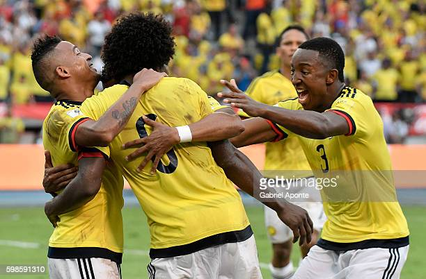 Macnelly Torres of Colombia celebrates with teammates after scoring the second goal of his team during a match between Colombia and Venezuela as part...