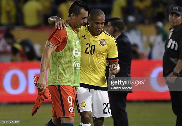Macnelly Torres of Colombia greets Esteban Paredes of Chile after a match between Colombia and Chile as part of FIFA 2018 World Cup Qualifiers at...