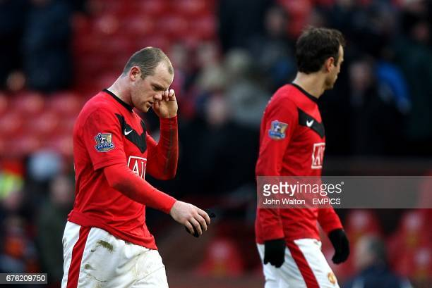 Macnhester United's Wayne Rooney Dimitar Berbatov stand dejected after the final whistle