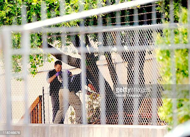Law enforcement gather evidence outside Lauren Giddings apartment complex at 1058 Georgia Ave Thursday morning Giddings was last seen by friends last...