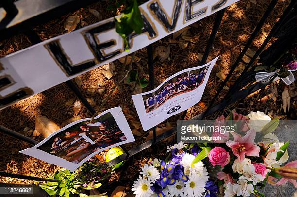 The fence in front of Lauren Giddings' apartment at 1058 Georgia Ave has been memorialized by her friends and others even as Macon Police guard the...