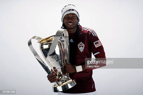 Macoumba Kandji of the Colorado Rapids poses with the Philip F Anschutz MLS Cup trophy following the MLS Cup final at BMO Field on November 21 2010...