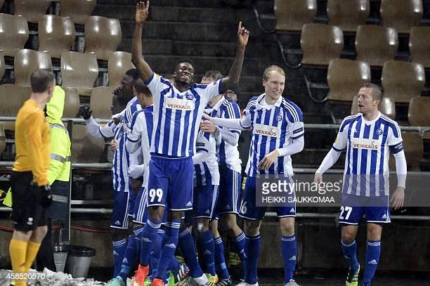 Macoumba Kandji , Valtteri Moren and Sebastian Sorsa of HJK Helsinki celebrate the 1-0 goal by Gideon Baah in the UEFA Europa League Group Stage...