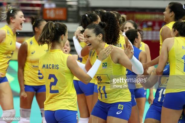 Macris Carneiro #11 Tandara Caixeta and team mates of Brazil celebrate winning the semi final match between Brazil and Serbia during 2017 Nanjing...