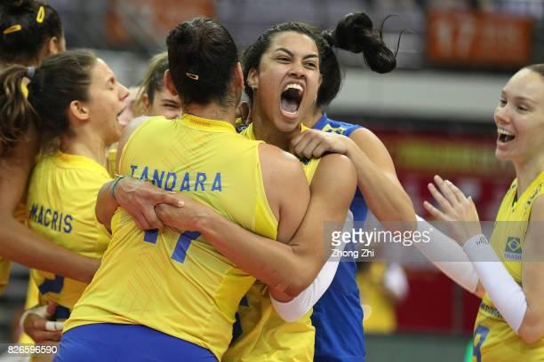 Macris Carneiro #9 Roberta Silva Ratzke #11 Tandara Caixeta #12 Natalia Pereira #16 Drussyla Costa and team mates of Brazil celebrate winning the...