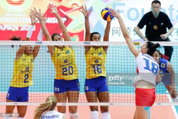 Macris Carneiro#16 Drussyla Costa and Ana Beatriz Correa of Brazil block during 2017 Nanjing FIVB World Grand Prix Finals between Brazil and Serbia...