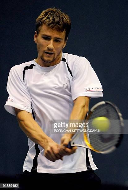 Macro Chiudinelli of Swiss returns to JoWilfried Tsonga of France during their quarterfinal round of ATP Thailand Open tennis tournament match in...