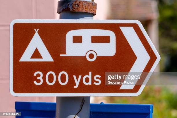 Macro close-up of direction sign for campsite, Shottisham, Suffolk, England, UK.