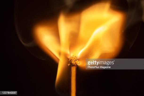 Macro detail of the match igniting into flame, taken on May 20, 2019.