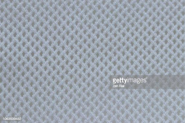 macro image of a white mesh textile - mesh textile stock pictures, royalty-free photos & images