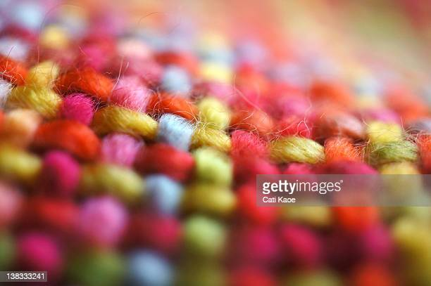 macro of multi colored fabric scarf - woven stock photos and pictures