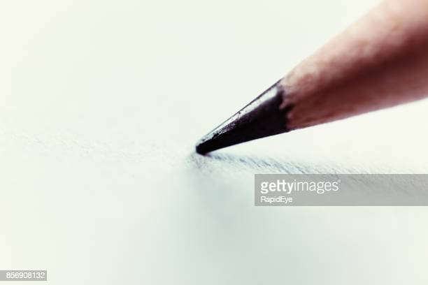 macro pencil tip resting on blank white paper - pencil stock pictures, royalty-free photos & images