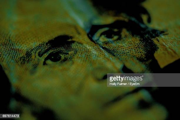 macro shot of andrew jackson on us paper currency - andrew jackson stock photos and pictures