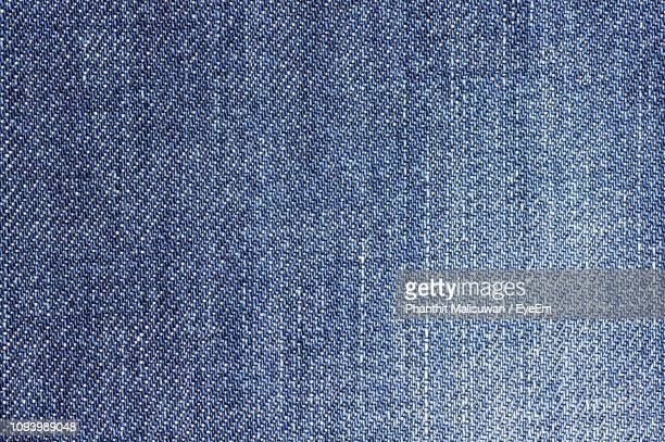 macro shot of textured pattern - jeans stock pictures, royalty-free photos & images