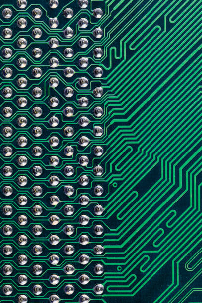 Macro shot showing rows of vias on a computer circuit board, United Kingdom