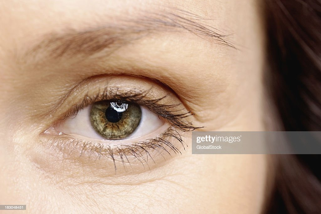 Macro view of a brown eye looking at you : Stock Photo