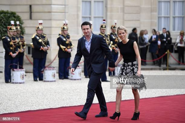 Macron's stepdaughter Tiphaine Auziere and her husband Antoine arrive at the Elysee presidential Palace to attend Emmanuel Macron's formal...
