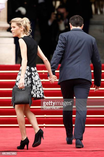 Macron's stepdaughter Tiphaine Auziere and her husband Antoine Choteau arrive at the Elysee presidential Palace to attend Emmanuel Macron's formal...