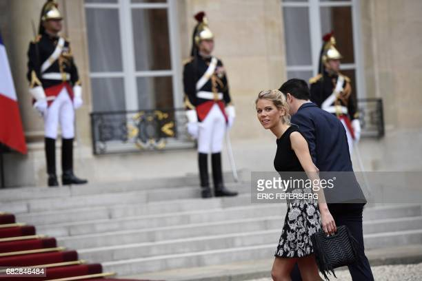 Macron's stepdaughter Tiphaine Auziere ans her husband Antoine Choteau arrive at the Elysee presidential Palace to attend Emmanuel Macron's formal...