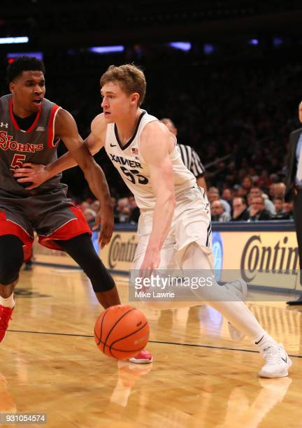 P Macura of the Xavier Musketeers handles the ball against Justin Simon of the St John's Red Storm in the second half during the Big East basketball...