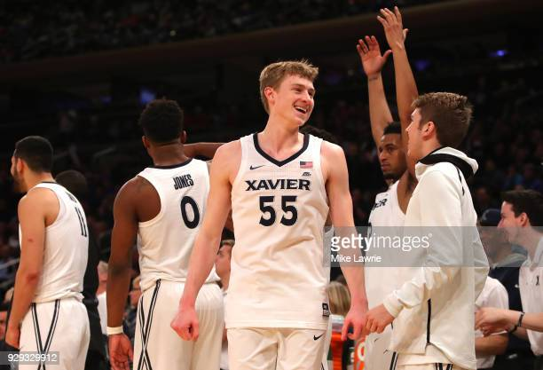 P Macura of the Xavier Musketeers reacts with teammates late in the game against the St John's Red Storm during the Big East basketball tournament...