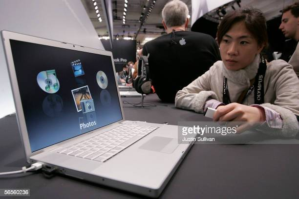 Macworld attendee looks at a new MacBook Pro laptop with Intel Core Duo processor during the 2006 Macworld January 10 2006 in San Francisco...