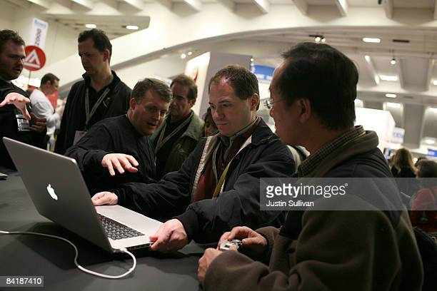 MacWorld attendees look at a display model of the new MacBook Pro 17 inch laptops during the MacWorld Conference January 6 2009 at the Moscone Center...