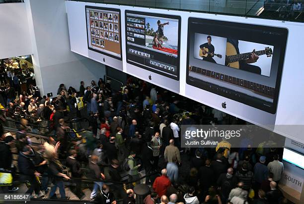 MacWorld attendees walk into the show floor following a keynote address by Apple Senior Vice President of Worldwide Marketing Philip Schiller during...