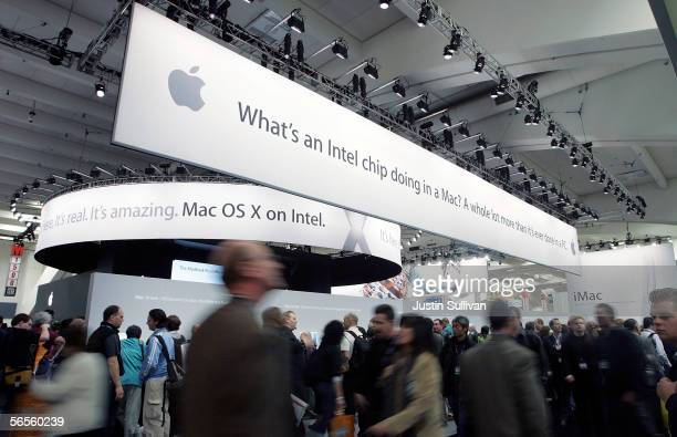 Macworld attendees walk on the show floor of the 2006 Macworld January 10 2006 in San Francisco California Jobs announced a new iMac with Intel Core...