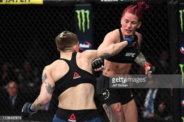 Macy Chiasson and Gina Mazany trade punches in their women's bantamweight bout during the UFC 235 event at TMobile Arena on March 2 2019 in Las Vegas...