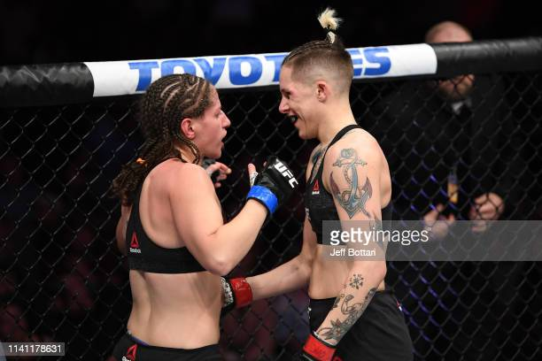 Macy Chiasson and Sarah Moras of Canada embrace after their women's bantamweight bout during the UFC Fight Night event at Canadian Tire Centre on May...