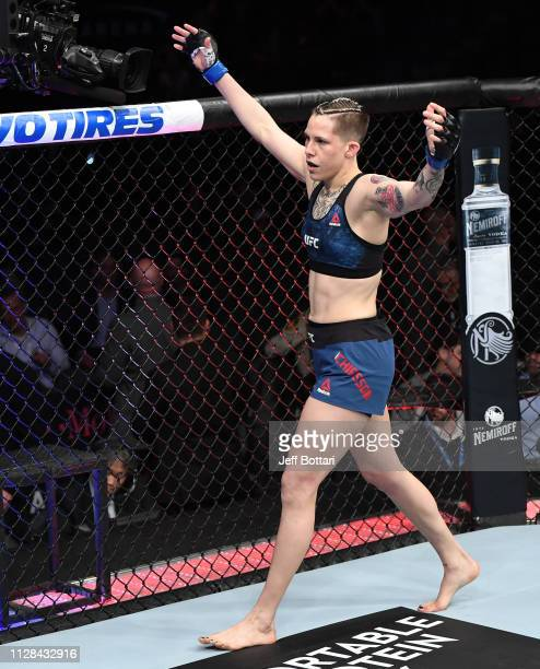 Macy Chiasson celebrates her knockout win against Gina Mazany in their women's bantamweight bout during the UFC 235 event at TMobile Arena on March 2...