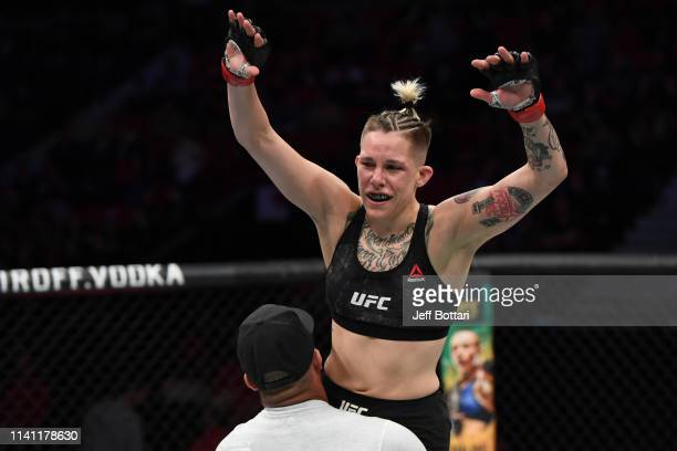 Macy Chiasson celebrates her TKO victory over Sarah Moras of Canada in their women's bantamweight bout during the UFC Fight Night event at Canadian...
