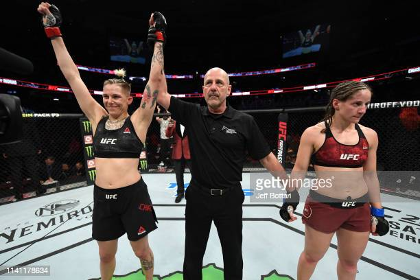 Macy Chiasson celebrates her victory over Sarah Moras of Canada in their women's bantamweight bout during the UFC Fight Night event at Canadian Tire...