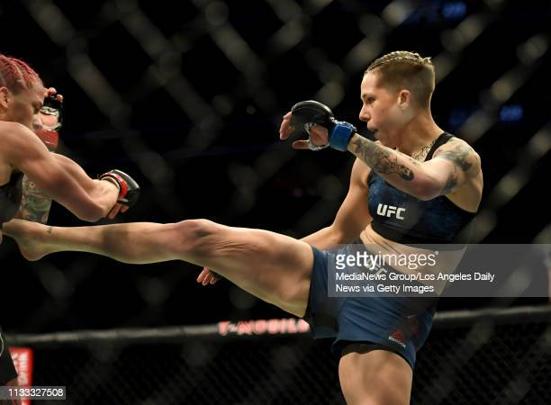 Macy Chiasson kicks Gina Mazany during UFC 235 at the TMobile Arena in Las Vegas NV Saturday Mar 2 2019 Chiasson defeated Mazany via TKO