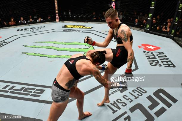 Macy Chiasson knees Lina Lansberg of Sweden in their women's bantamweight bout during the UFC Fight Night event at Royal Arena on September 28 2019...