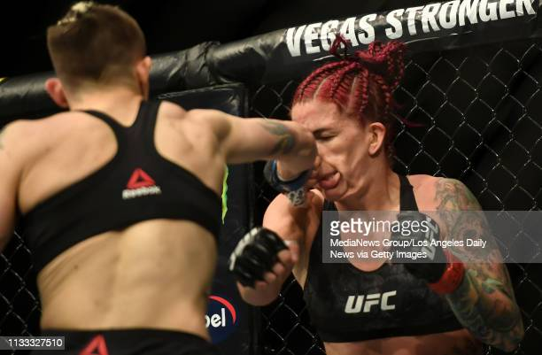 Macy Chiasson lands a hard punch to the face of Gina Mazany during UFC 235 at the TMobile Arena in Las Vegas NV Saturday Mar 2 2019 Chiasson defeated...