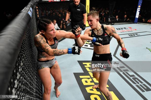 Macy Chiasson punches Lina Lansberg of Sweden in their women's bantamweight bout during the UFC Fight Night event at Royal Arena on September 28 2019...
