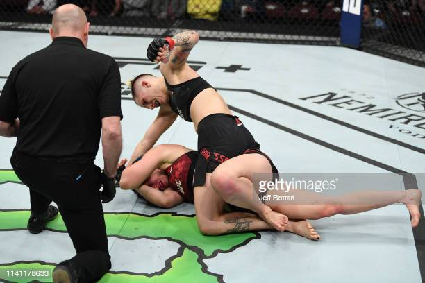 Macy Chiasson punches Sarah Moras of Canada in their women's bantamweight bout during the UFC Fight Night event at Canadian Tire Centre on May 4 2019...