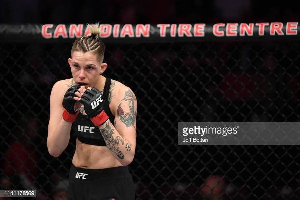 Macy Chiasson stands in her corner prior to the second round of her women's bantamweight bout against Sarah Moras of Canada during the UFC Fight...