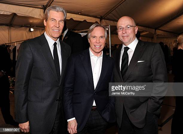 Macy's CEO Terry Lundgren designer Tommy Hilfiger and Esquire editorinchief David Granger pose backstage at the Tommy Hilfiger Presents Fall 2012...