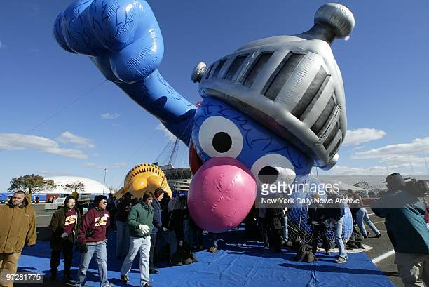 Macy's crew inflates the new Super Grover character balloon and takes it for a test flight in the parking lot at Giants Stadium The monumental Muppet...